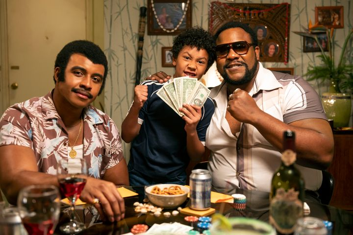 "From left: Joseph Lee Anderson as Rocky Johnson, Adrian Groulx as Dwayne, and Nate Jackson as Junkyard Dog in ""Young Rock."""