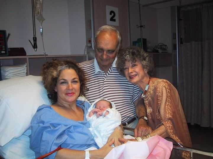Joanna Gualtieri pictured with her mother and father after giving birth to son Sebastien.