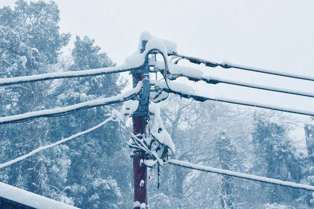 The telegraph pole in a snow