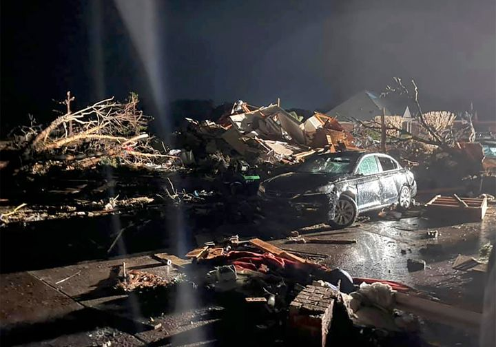 A damaged vehicle is seen among debris after a deadly tornado tore through Brunswick County, N.C., Tuesday, Feb. 16, 2021. (E