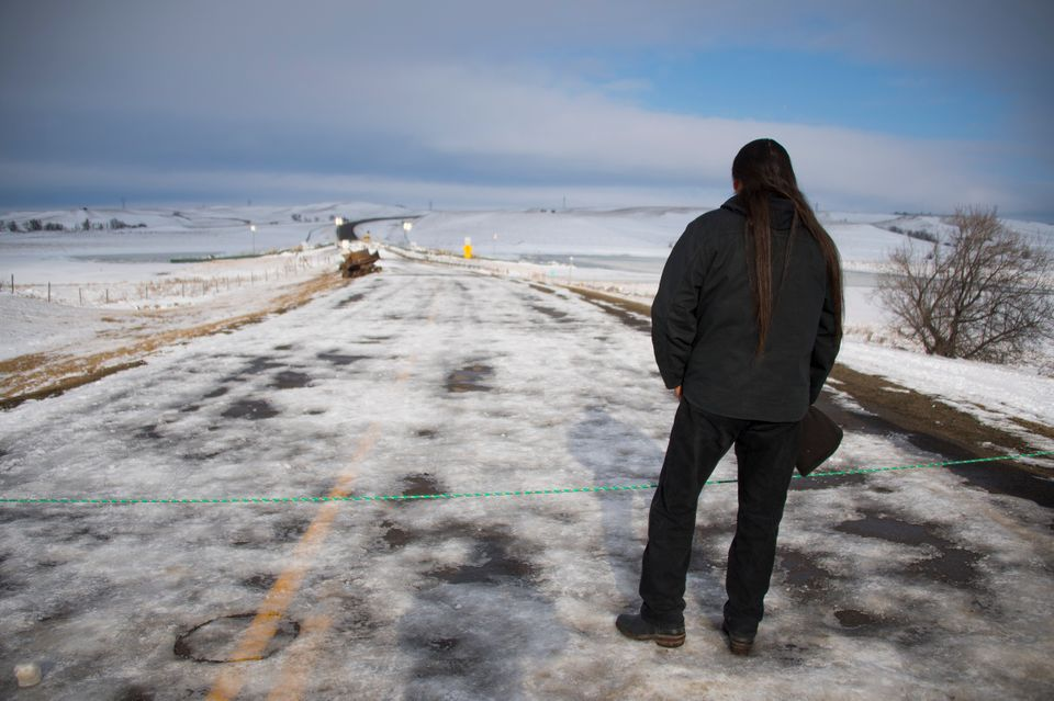 Activist Pete Sands of the Navajo Nation looks out over an area set as a borderline where the police...