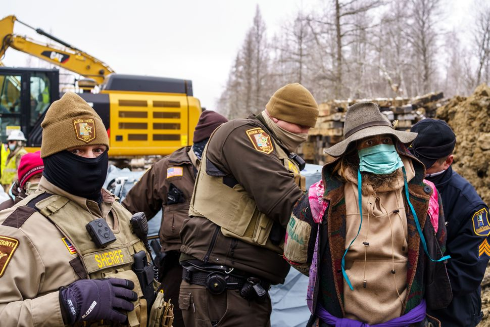 "Sheriffs in Aitkin County, Minnesota, arrest ""water protectors"" during a protest at the construction site of the Line 3 oil p"