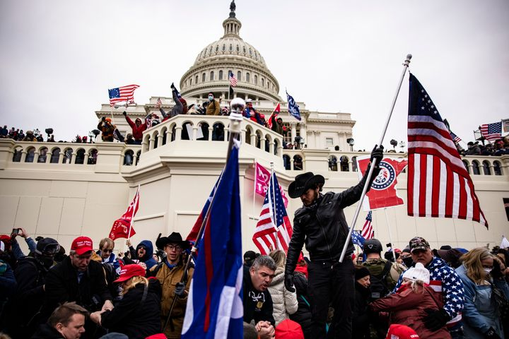 Trump supporters storm the U.S. Capitol following a rally with President Donald Trump on Jan. 6. At his Senate impeachment tr