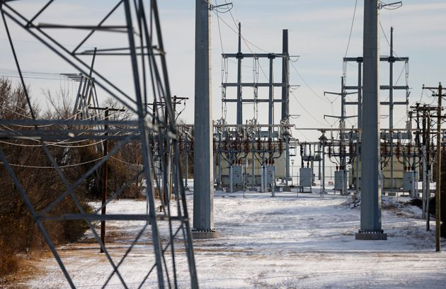 Transmission towers and power lines lead to a substation after a snowstorm on Feb. 16, 2021, in Fort...