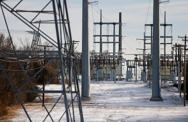 Transmission towers and power lines lead to a substation after a snowstorm on Feb. 16, 2021, in Fort Worth, Texas.