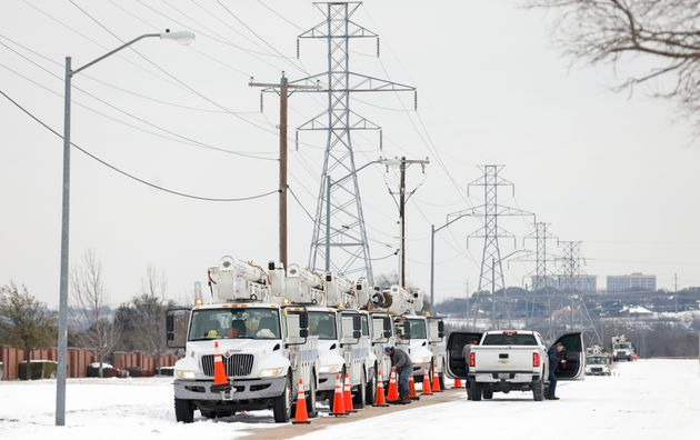 Pike Electric service trucks line up after the snowstorm on Feb. 16 in Fort Worth,