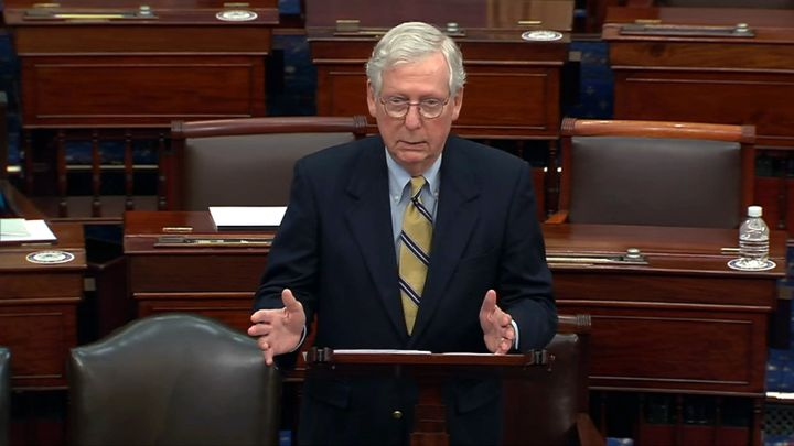 Minority leader Senator Mitch McConnell responds after the Senate voted 57-43 to acquit on the fifth day of former President Donald Trump's second impeachment trial at the US Capitol on February 13, 2021 in Washington, DC.