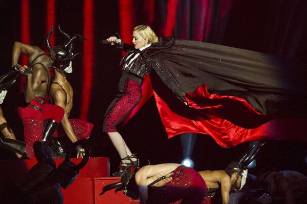 Madonna falls off stage at the