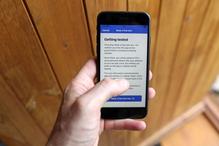 The NHS Covid-19 mobile phone application instructs the user on how to book a test.
