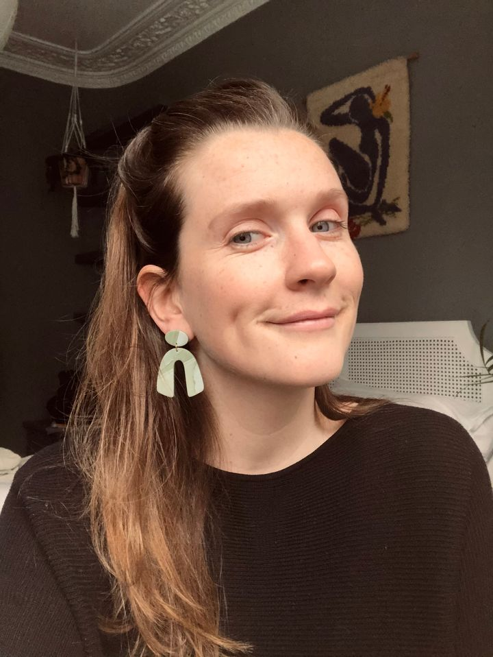 Claire Owens wearing handmade clay earrings. She set up a jewellery venture, while also working full time, in 2020.