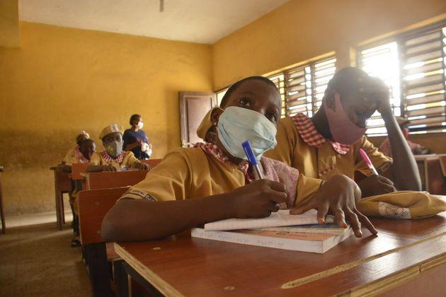 Students of Opebi Junior High School resume class on their first day of resumption amid the coronavirus...