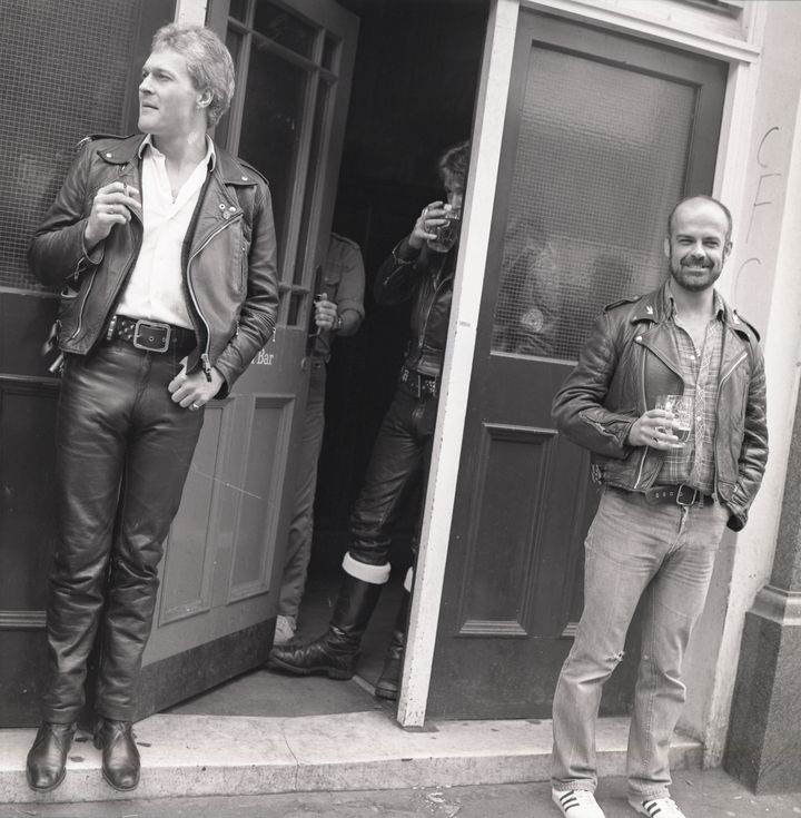 Bryan Derbyshire (holding pint), magazine editor and notable figure on the leather scene, and others outside The Coleherne, 1978
