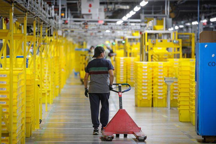 An employee pulls a cart at Amazon's JFK8 distribution center in Staten Island, New York, on Nov. 25, 2020.