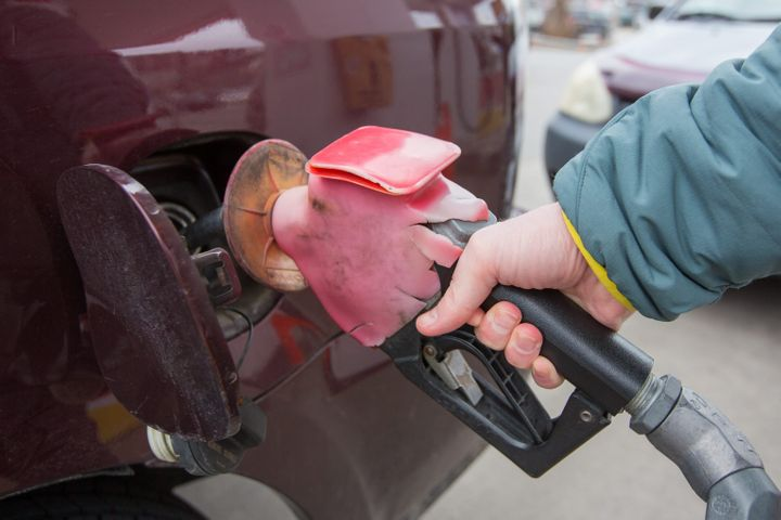 A person pumps a vehicle with gasoline at Shell gas station in Kingston, Ontario on Thursday, April 18, 2019.Only one person per household can claim the federal carbon tax rebate.