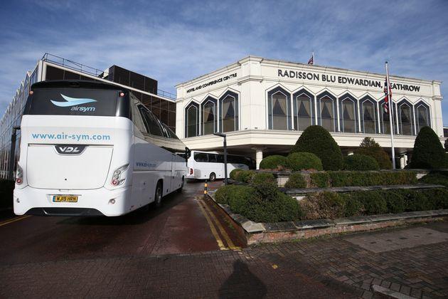 A coach carrying passengers arrives at the Radisson Blu Edwardian Hotel, near Heathrow Airport, London,...