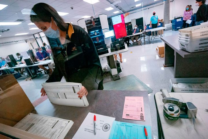 A poll worker sorts ballots inside the Maricopa County Election Department in Phoenix on Nov. 5, 2020.