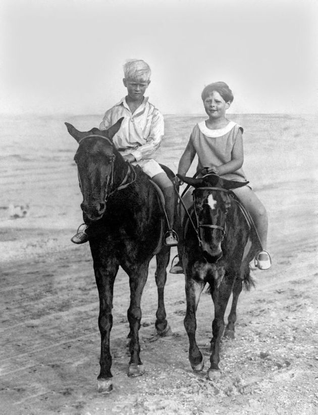 Prince Philip of Greece (left) rides with his cousin King Michael of Romania on the sands at Constanza...