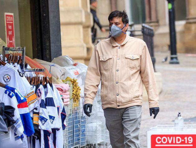 A member of the public wears a face mask in, Bradford in