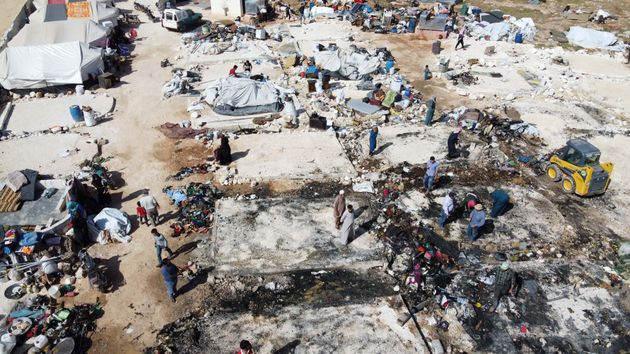 An aerial view shows charred tents after a fire destroyed dozens of temporary shelters housing displaced...