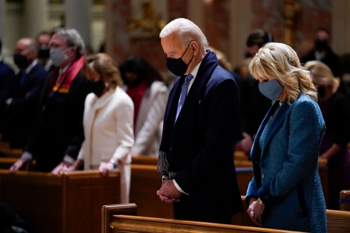 Joe and Jill Biden attend Mass at the Cathedral of St. Matthew the Apostle during Inauguration Day ceremonies on Jan. 20, 202
