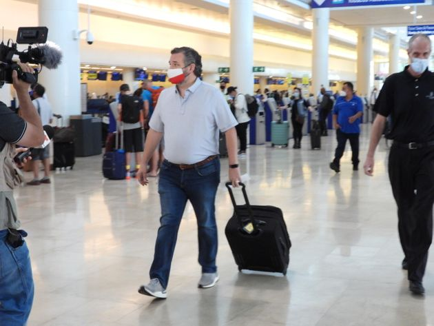 Sen. Ted Cruz (R-Texas) checks in Thursday for a flight at Cancun International Airport after backlash...
