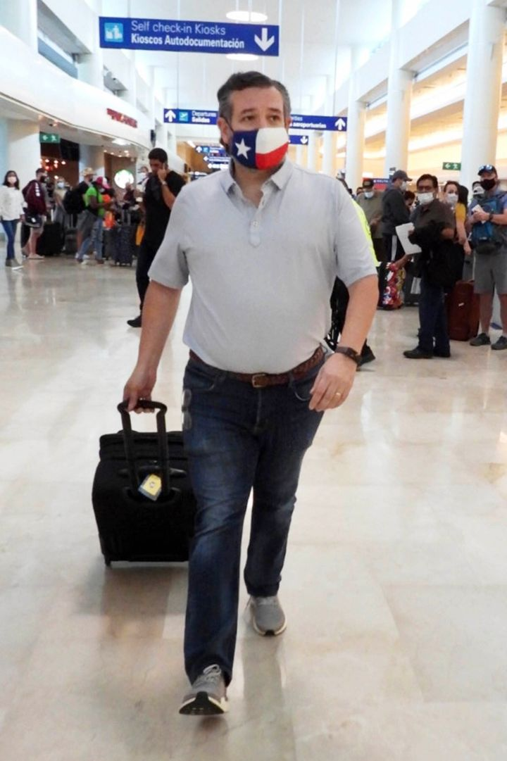 Sen. Ted Cruz (R-Texas) checks in for a flight at Cancun International Airport after a backlash over his family vacation to M