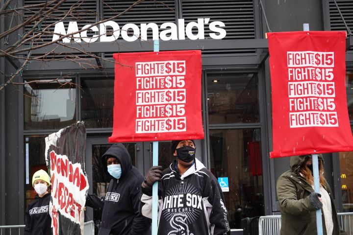Demonstrators participate in a protest outside of McDonald's corporate headquarters on Jan. 15, 2021, in Chicago, Illinois. T