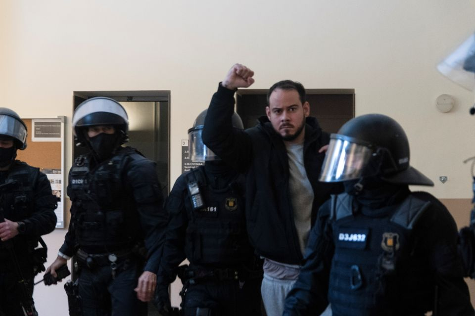 Spanish rapper Pablo Hasel reacts as he is detained by riot police inside the University of Lleida, after...