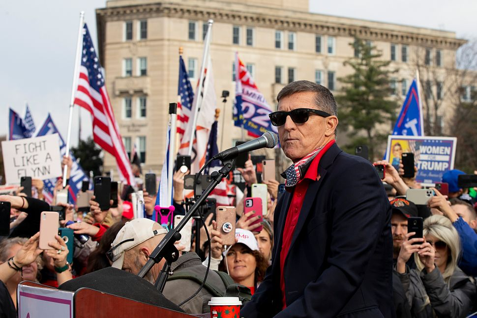 Michael Flynn speaks to a crowd of Trump supporters during a protest against the outcome of the presidential election outside