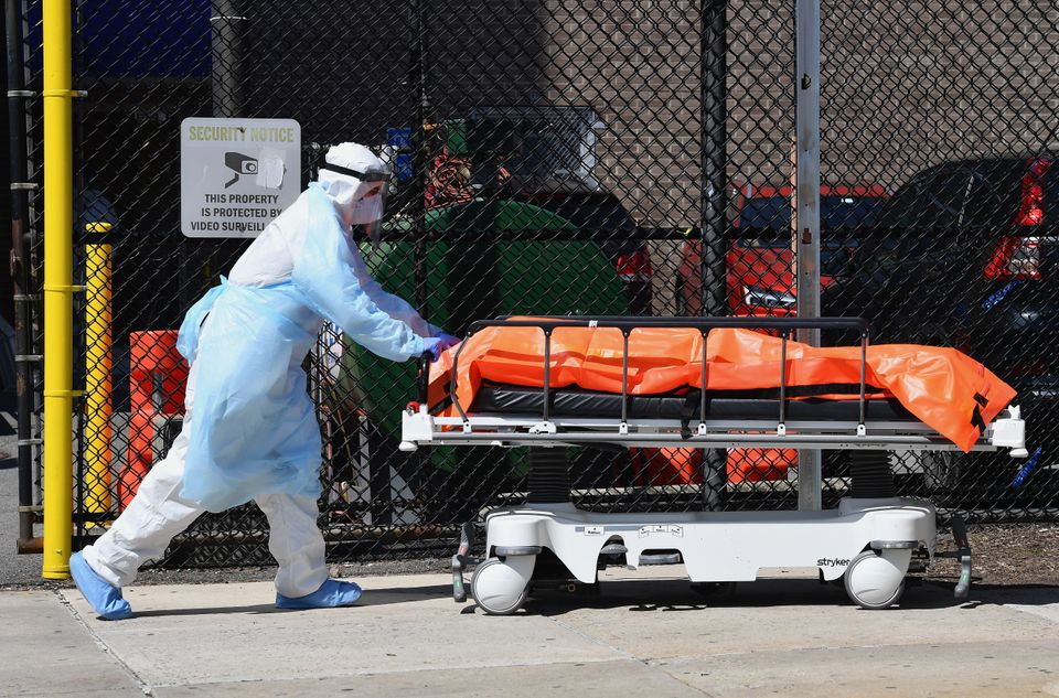 A staff member atthe Wyckoff Heights Medical Center in New York moves a body to a refrigerated...