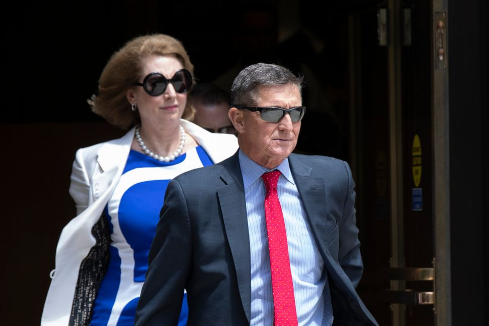 Flynn leaves the federal courthouse in Washington on June 24, 2019, followed by his lawyer Sidney Powell. She would become fa
