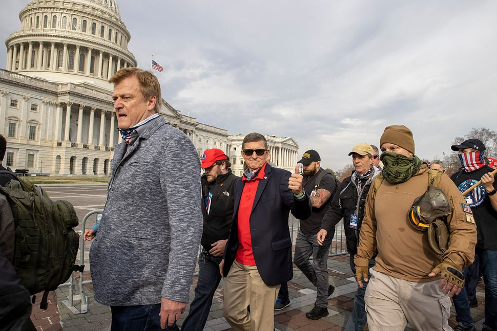 Flynn departs the Dec. 12, 2020, protest where he said Trump supporters trying to flip the election results were fighting&nbs