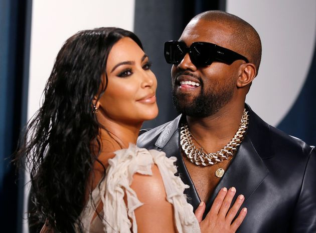 Kim Kardashian and Kanye West attend the Vanity Fair Oscar party in