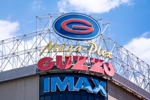 A Guzzo cinema sign is seen on a storefront in Montreal on June 18,