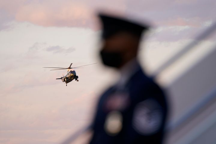 FILE - In this Feb. 5, 2021, file photo Marine One, with President Joe Biden aboard, is seen past a member of the U.S. Air Fo