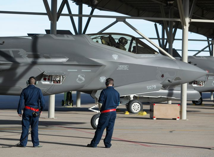Ground crew members prepare an F-35 fighter jet for a training mission at Hill Air Force Base on March 15, 2017 in Ogden, Uta