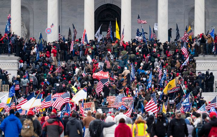 Trump supporters storm the steps of the U.S. Capitol on Jan. 6 as Congress gathered to certify the electoral votes for Joe Bi