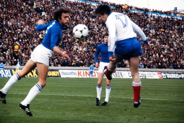 French forward Bernard Lacombe (R) heads the ball past Italian defender Mauro Bellugi (L) during the...