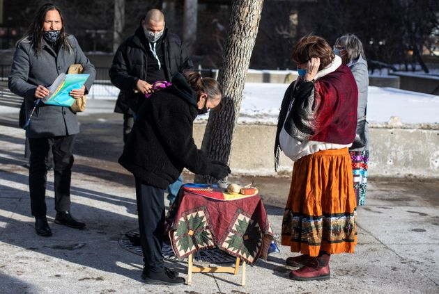 Donna McLeod, Cindy Gladue's mom, takes part in smudging during a rally for Cindy Gladue outside the...