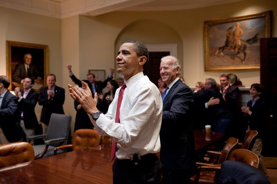 Joe Biden, seen here with then-President Barack Obama celebratingHouse passage of the Affordable Care Act in 2010, now