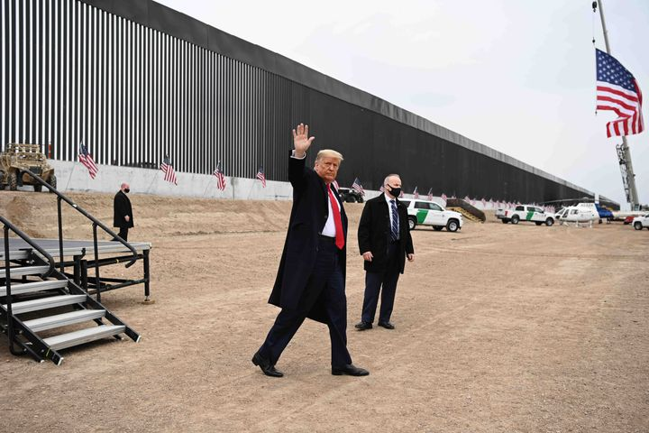 Donald Trump waves after speaking and touring a section of the border wall in Alamo, Texas, near the end of his presidency on