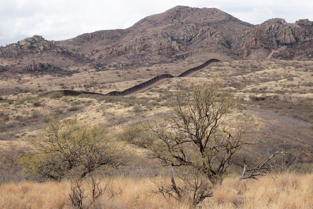 A new section of the border wall built under President Donald Trump extends through the remote wilderness...