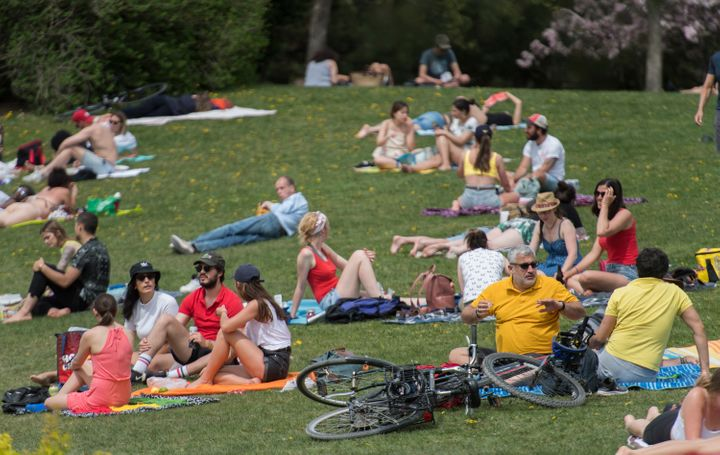There was some return to normalcy in the spring, when people could safely see each other outside, as they did in this photo from a Montreal park in May.