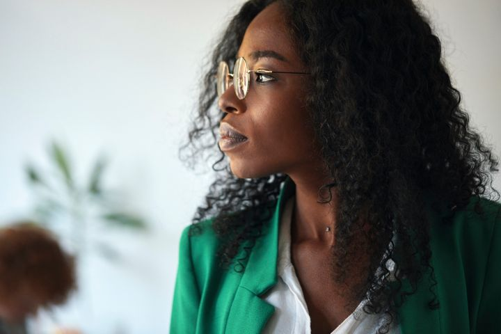 A businesswoman looks to the side in her office.