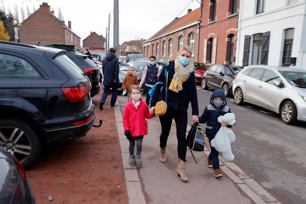 French anaesthesiologist Caroline Tesse, 34, walks with her children Margaux and Louis to school in Villeneuve