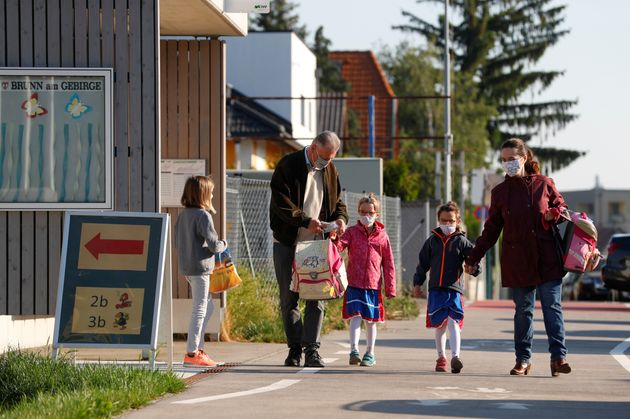 Children with their parents arrive at a primary school in Brunn am Gebirge,Austria, May