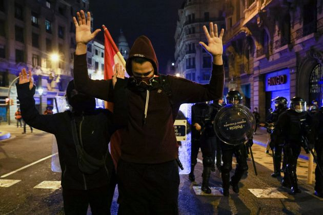 People hold their hands up during a protest in support of rap singer Pablo Hasel after he was given a...