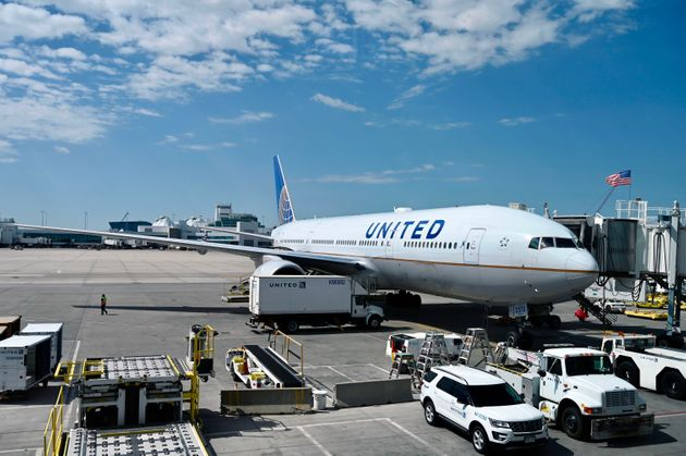 A Boeing 777 belonging to United Airlines is seen at the gate at Denver International Airport in Denver...