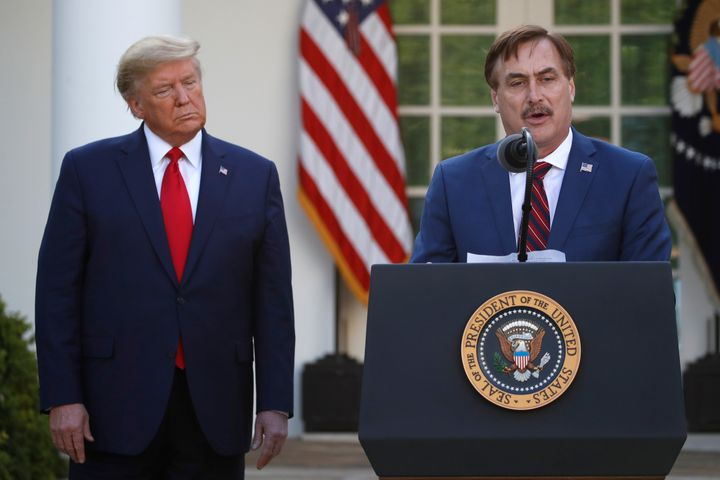 In this March 30, 2020, file photo, My Pillow CEO Mike Lindell speaks as then-President Donald Trump listens during a briefin