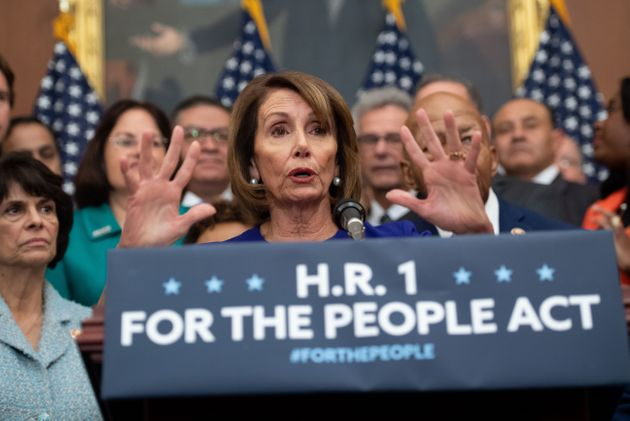 Speaker of the House Nancy Pelosi (Calif.) speaks alongside Democratic members of the House about H.R.1,...